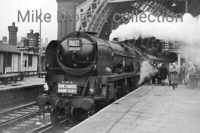 Home Counties Railway Society: Derby & Burton Special 1/3/64 Bulleid rebuilt Merchant navy pacific no. 35003 Royal Mail awaits departure at St. Pancras station in London. The trip took in visits to Derby works and shed as well as the shed at Burton-on-Trent. Note the small 'DERBY' plaque just above the buffer beam.