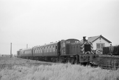 """RCTS: Derwent Valley Light Railway Tour 16/1/65 This tour seems to have been little photographed and so it's a pleasure to show off this shot of BR class 03 0-6-0DM no. D2111 at Thorganby (closed to passengers on 1/9/26) on the DVLR. Some additional notes from Vic Smith: """"The coach at the rear is a 1905 ex-SECR 6 wheeled full brake number 1601. When the DVLR closed it was acquired by the Bluebell Railway and can now be found at the Chasewater Railway.  The photo shows the repeat of the previous weeks railtour, this time with the addition of the brake van to satisfy the members who complained about the lack of sustenance and mugs of Yorkshire tea!"""" [Mike Morant collection]"""