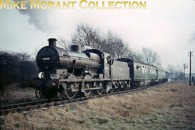 LCGB: The Maunsell Commemorative Rail Tour 3/1/65 Southern Maunsell 'Q' class 0-6-0 no. 30545 top-and-tailed with Maunsell 'U' class mogul no. 31639 on the Merton Abbey branch from Merton Park and is depicted here at the tail end of the stock on the way to Merton Abbey. [Mike Morant collection]
