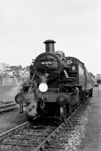 LCGB: The East Devon (No.1) 28/2/65 Exmouth Junction allocated Ivatt 'Mickey Mouse' 2MT 2-6-2T no. 41291 heads the supplementary leg of this tour and awaits departure for Lyme Regis at Axminster station with classmate 41206 at the rear. [Mike Morant collection]