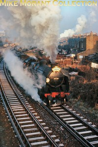 LCGB: The Maunsell Commemorative Rail Tour 3/1/65 Spruced up Maunsell 'U' class mogul no. 31639 with 'Q' class 0-6-0 no. 30545 at the rear negotiates the frost laden curve between Wimbledon and Merton Park on their way to Tooting Goods.. [Slide taken by Mke Morant]