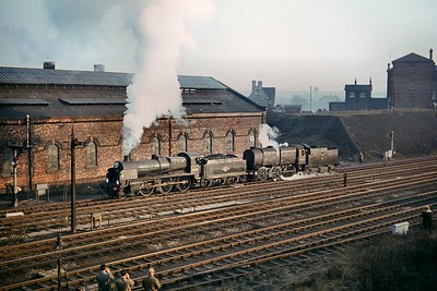 HCRS: Six Counties Railtour 7/3/65 This ambitious tour was the 13th and last tour organised by the Home Counties Railway Society and started and ended at Paddington station. This shot was taken in bitterly cold conditions whilst the engines, Bulleid Q1 class 0-6-0 no. 33006 and Maunsell 'U' class mogul no. 31639 both Guildford allocated at the time, make their way from Wellingborough stationto the former LMS shed for servicing. The trip ran consistently behind schedule and lasted four minutes short of twelve hours with the arrival time at Paddington being some fifty minutes later than scheduled. [Mike Morant collection]