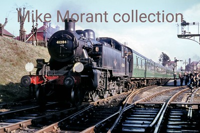 LCGB: The Dorset Belle Rail Tour 27/2/66 Ivatt 'Mickey Mouse' 2MT 2-6-2T no. 41284 is the train engine for the return leg from Swanage, as seen here, and Wareham. It's strange how one loco can turn up time and again in a collection. This one is represented in my film collection at Chesham, Chalfont, Nine Elms shed and Bournemouth as well as several times during this jolly.