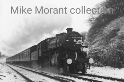 WRS: The Midlander Tour 12/2/66 Warwrickshire Railway Society The Midlander hauled by Ivatt Flying Pig 4MT 2-6-0 No. 43002. I've no idea of the location though.