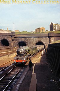 The preserved Gresley A3 pacific no. 4472 Flying Scotsman made a rare daytime entry into King's Cross on October 20th 1968 and is seen here at a signal check by the former site of the Copenhagen signalbox. This tour emanated from Leeds and was sponsored by Flying Scotsman Enterprises. There were intermediate stops at Wakefield, Doncaster, Retford and Grantham plus an LT Underground Northern Line special train from King's Cross to Clapham for a special opening at the Museum of British Transport there. [Slide taken by Mike Morant]