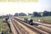 <center><b>H.P. Bulmer Ltd.: Return to Steam Stage 1 2/10/71</b></center> The famed 'return of mainline steam' with the preserved GWR Collett King class 4-6-0 no. 6000 <i>King George V</i> accompanied by the Bulmer's Cider train at Undy, close to Severn Tunnel Junction.<br> [<i>Mike Morant collection</i>]