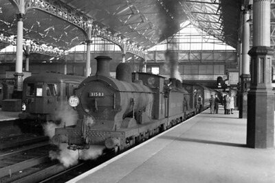 British Railways: Ramblers excursion 21/10/51. The rare sight of a pair of Wainwright 'C' class 0-6-0's double-heading a passenger train and in charge of train that would run entirely on LBSCR metals. This special is depicted on the Brighton side of Victoria station and was schedukled for departure at 9.37 a.m. to run via West Croydon, Sutton, Leatherhead and Guildford to Cranleigh which was the destination with the return journey taking the same route. The leading engine is Gillingham allocated no. 31583 whilst the train engine is Stewarts Lane allocated no. 31576. [Mike Morant collection]