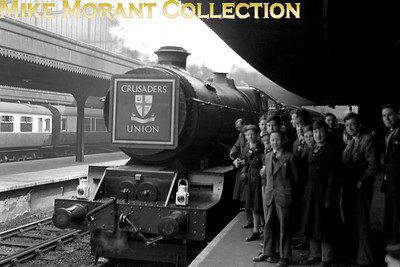 "Crusaders Union: Swindon Works Special 10/4/51Collett King class 4-6-0 No.6003 King William IV was selected for the first Crusaders Union special to run after WW2. These CU specials, this one to Swindon for a works visit in 1951, were organised by the late Cecil J. Allen who had been responsible for the concept of such special trains back as far as his first effort in 1929 which attracted 1,970 applicants. So, 'trainspotting' goes a lot further back than the inception of Ian Allen's ABC's in this country! [Graham Feakins; John Oliver]The final piece of the puzzle has been slotted into place by the redoubtable Peter Kellett: From the May 1951 RO page 103. ""On 10/4/51 'King' 6003 (81A) hauled a ten-coach Crusaders' Union educational excursion from Paddington to Swindon and back, carrying a large green headboard with the Crusaders' coat-of-arms on the smokebox door.""And just when I thought I knew everything relevant about this shot I received a message from Nigel Spencer who informs me that he tracked down the original headboard and It is now stored at Westbrook – the Crusaders' Victorian mansion near Seaview (Isle of Wight)."