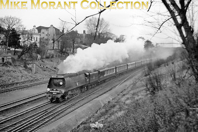 Bulleid original Merchant Navy pacific no. 35015 Rotterdam Lloyd in charge of the Down Bournemouth Belle at Surbiton. This shot isn't dated but note that the headboard is the original version mounted above the buffer beam. [Mike Morant collection]