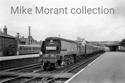Good shots of ocean liner expresses are always thin on the ground making this one something of a pleasure to see. Bulleid original light pacific no. 34010 Sidmouth is depicted on the through road whilst in charge of a down Union Castle Express on August 16th, 1956. Sidmouth would be modified in January 1959 whilst allocated to Nine Elms and it would be withdrawn as an Eastleigh engine in March 1965 but has survived to the present day although not yet as a working engine. The rolling stock is worth more than just a glance. [Mike Morant collection]
