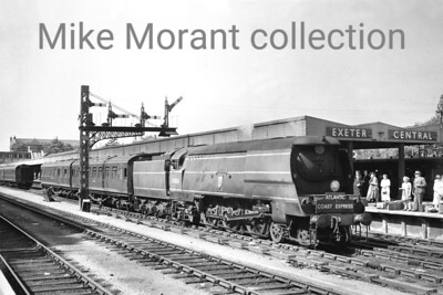 Bulleid original West Country class pacific No. 34006 Bude in BR malachite livery but with no declaration of ownership on the tender marshalls the formation of the up Atlantic Coast Express at Exeter Central on 21/8/49. 34006 entered traffic in 1945 as 21C106 and received its BR number in March 1948 whilst allocated to Exmouth Junction which was still the case when this shot was taken. Bude didn't quite see out the end of Southern steam as withdrawal came from Salisbury mpd in March 1967. [Mike Morant collection]