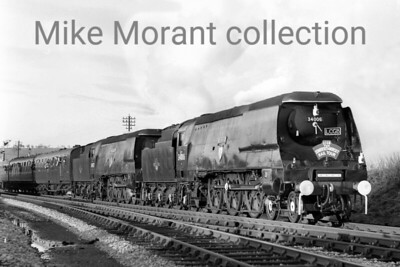 LCGB: Somerset & Dorset Rail Tour 5/3/66 This tour ran on the penultimate day for the S & D and is notable for being the only known occasion when that railway played host to a Merchant Navy pacific and also the exquisite sight of spotless double-headed Bulleid light pacifics which took over haulage duties from Evercreech Junction to Bath followed by the return as far as Bournemouth Central. West Country no. 34006 Bude and Battle of Britain no. 34057 Biggin Hill are depicted here departing from Templecombe Upper on that last leg. [Mike Morant collection]