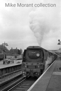 Bulleid original 'Battle of Britain' pacific no. 34068 Kenley in charge of an Up semi-fast service to Waterloo at Woking station on 18/7/63. Kenley was one of the earliest Bulleid pacific withdrawals succumbing in December 1963 whilst allocated to Salisbury depot.  [Mike Morant collection]