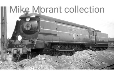 Bulleid original Battle of Britain light pacific no. s21C149 Anti-Aircraft Command at Exmouth Junction mpd with the early 'S' prefix British Railways number, BRITISH RAILWAYS legend on the tender and still wearing the Southern roundel on her smokebox, which dates the photograoh as being between 13th March 1948 and 18th February 1949, during which time the loco was allocated to Salisbury shed. I believe that I should also mention that the smoke deflectors have been extended but I don't know for how long that modification remained in place. [A. E. 'Dusty' Durrant / Mike Morant collection]
