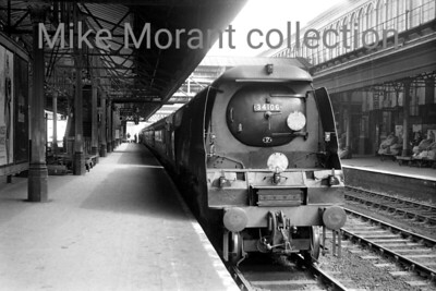 Bulleid original West Country class pacific no. 34106 Lydford awaits departure time at Exeter St. David's in July 1961. 34106 was an Exmouth Junction engine at the time and would remain there until withdrawal in September 1964. [Mike Morant collection]