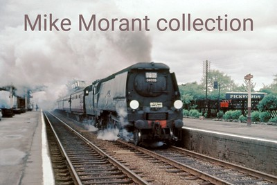 """RCTS/LCGB: North Midlands Rail Tour  11/5/63 Bulleid original West Country pacific No. 34006 Bude passes the unlikely location of Mill Hill Broadway station on a very dull May morning in May 1963. This tour wasn't the greatest of successes as 34006 allegedly let the side down with late running on both the Down leg from St. Pancras to Derby and the Up leg from Burton to St. Pancras but see the addendum below which is revealing. In any event, the visit to Derby works had to be by-passed as a result of the late running.  Harry Richardson has sent me the following from the horse's mouth so to speak:  """"I was the fieman on the return trip of this tour whilst my driver was Joe Smiddy and we were both stationed at Kentish Town Loco. Bude was in a wicked state. The coal wasn't up to main line work and my mate had lots of trouble with the steam reverser."""""""