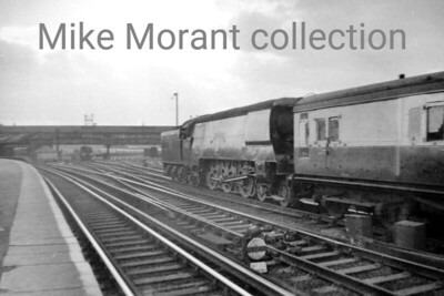 Not a great shot quality-wise it must be said. Bulleid original light pacific no. 34008 Padstow eases empty stock towards the carriage sidings at Clapham Junction. Photo taken by Mike Morant