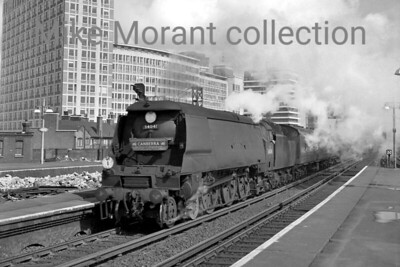 Bulleid original light pacific no. 34041 Wilton in charge of a down P & O Orient Lines 'CANBERRA' boat train passes through Vauxhall station on 25/7/65. [Mike Morant collection]