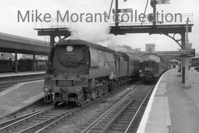 Bulleid original West Country class pacific no. 34011 Tavistock departs from Exeter St. David's with an Ilfracombe-bound service. 34011 was an Exmouth Junction engine from May 1958 until withdrawal in November 1963 which was one of the earliest withdrawals of this class. This shot has much peripheral interest in the form of an NBL Type 2 diesel hydraulic on the right and a 'sandwiched' Collett 1400 class in the bay at the left. [Mike Morant collection]
