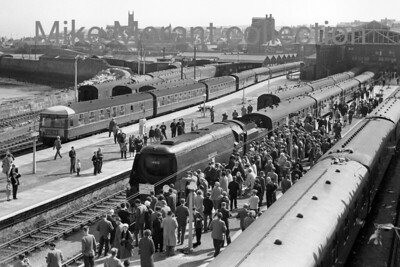 RCTS / Plymouth Railway Circle: The Cornubian 3/5/64 Bulleid original West Country pacific no. 34002 Salisbury hauled this special from Plymouth to Penzance and back. This fine view at Penzance shows 34002 flanked by a horde of admirers prior to departure at 16.25. The jagged shadows on the carriage roofs at the right hand side of the picture are shadows of the onlookers on Chyandour Cliff. [Mike Morant collection]