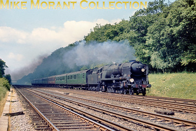 There was quite a bit of steam activity at or near Hook on June 10th 1967 just a month before the cessation of steam operations in the south of England. Seen here at speed is rebuilt Bulleid light pacific No. 34008 with an Up Bournemouth train which is occupying the slow line.