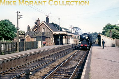 Bulleid rebuilt light pacific no. 34021 Dartmoor arrives at Morton station whilst in charge of the 13.30 Waterloo - Weymouth service on 6/'6/65. [Mike Morant collection]