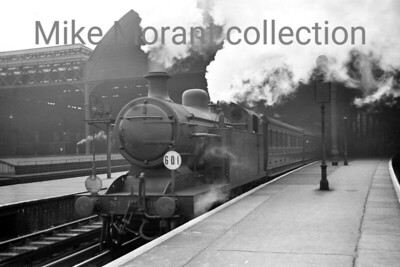 Ex-LBSCR Marsh I3 class 4-4-2T no. 2001 in charge of an Oxted line train departs from London Bridge station on 22/10/38. The 'roof' to the left of 2001 has aroused interest amongst viewers and was the lamp room between platforms 17 and 18 which had an inclined walkway leading down to it. [J. H. Venn / Mike Morant collection]
