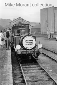 Caterham Railway Company: Caterham Centenarian 6/8/56 This very short trip in appalling weather  - I was soaked through to the skin cycling from Thornton Heath to Caterham to see it -  saw the Brighton Works shunter, Stroudley Terrier 377S, journey from Purley to Caterham and back in the company of red liveried SECR birdcage set no. 580. Here we see the ensemble resting at Caterham station. [Mike Morant collection]