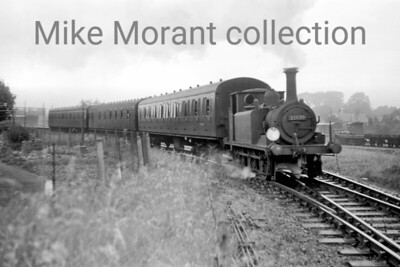 Stroudley A1X 'Terrier' 0-6-0T no. 32670 leaves Havant with a service bound for Hayling Island. [Mike Morant collection]