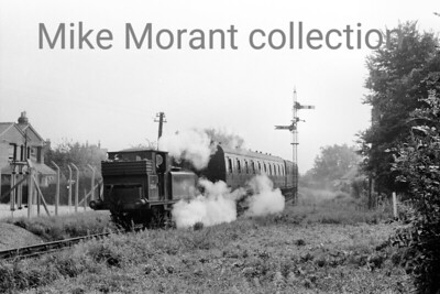 LBSCR Stroudley A1X 'Terrier' 0-6-0T in familiar territory hauling a Hayking Island train on the outskirts of Havant. The unusual signal post arrangement is noteworthy.