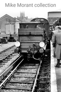 Caterham Railway Company: Caterham Centenarian 6/8/56 This very short trip in appalling weather  - I was soaked through to the skin cycling from Thornton Heath to Caterham to see it -  saw the Brighton Works shunter, Stroudley Terrier 377S, journey from Purley to Caterham and back in the company of red liveried SECR birdcage set no. 580. Here we see the ensemble preparing for the return journey from Caterham station. [Mike Morant collection]