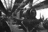 Former LBSCR Stroudley 'Terrier' class 0-6-0T no. 32661 undergoes repairs inside Brighton works on 23-6-56. A chancy shot for a 13 year old using a plastic camera. Does anyone recognise the Leslie Phillips lookalike at the right hand side of the image?