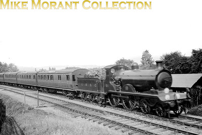 LBSCR  RJ Billinton designed B4 class 4-4-0 no. 51 in Marsh's umber livery. No. 51 was built by Sharp Stewart in 1901 and soldiered on until withdrawal in February 1949 as SR no. 2051. The official allocation at that time was Horsham mpd but the reality was that 2051 had been stored at Bognor since 1947 according to the notes I have here. Martin sale has informed me that this shot is post-WW1 and that the headcode suggests London Bridge and Hastings via Through (Quarry) Line and Keymer Line. That supports my view that the location is to the east of Brighton. [Gurney Smith / Mike Morant collection]