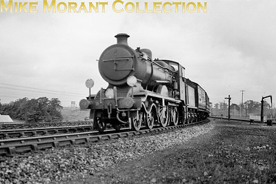 An unidentified Ex-LBSCR B4X 4-4-0, only B7? Is visible, in charge of a London Bridge - Redhill - Three-Bridges - Portsmouth service departs from Three Bridges on the line to Horsham. [Mike Morant collection]