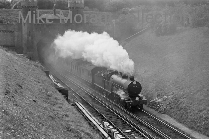 Former LBSCR Marsh H2 class 4-4-2 no. 32424 <i>Beachy Head</i> bursts from the stygian gloom of Clayton tunnel on an unspecified date in September 1957.<br> [<i>Mike Morant collection</i>]