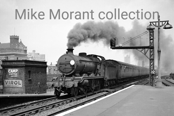 Billinton 'K' class 2-6-0 no. 2342 is depicted here passing Vauxhall whilst hauling a rake of GER air-braked suburban stock.The working is a Farnborough air show special on July 8th 1950. 2342 would be renumbered to BR 32342 in the same monthat this shot was taken whilst allocated to Brighton mpd from which shed withdrawal came in December 1962 as part of the Southern's slaughter of just about everything interesting on the motive power front.<br> [<i>Mike Morant collection</i>]