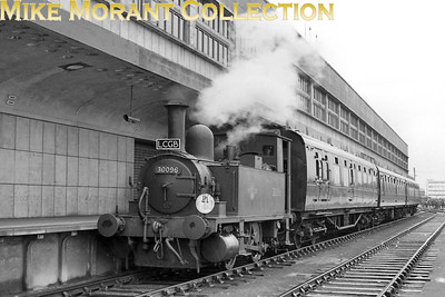 """LCGB: The """"B4"""" Dock Tank Rail Tour (No.1) 9/3/63 LSWR Adams B4 dock tank No. 30096 is depicted here Southampton Ocean Terminal. The tour started at Winchester Chesil, visited Ocean Terminal in Southampton, Eastleigh works and then terminated at Winchester City. 30096 had originally been named Normandy and would be named again when sold out of service to Corrall who named her Corrall Queen. In 1972 he was again sold on but this time to the Bulleid Pacific Preservation Society (later renamed The Bulleid Society) and the locomotive is, of course, now located on The Bluebell Railway. [Mike Morant collection]"""