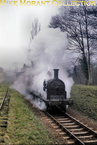 Drummond M7 0-4-4T 30055 departs from Grange Road en route for East Grinstead on a cold and misty morning in April 1963.