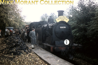 REC: Aldershot Area Rail Tour 15/10/60 It's a shame about the image quality but one suspects that the light was unsuitable for colour photography. The depicted loco is Eastleigh allocated Drummond M7 class 0-4-4T no. 30028 whilst the unlikely location is Treloars Hospital Platform or Treloars Siding which was the last remaining stub of the Basingstoke and Alton Light Railway. Although that railway had become defunct as far back as 1932 this stub remained in use for freight traffic until 1967. the B & ALR is famed for its use for filming and in particular Cliddesden station was the setting for Buggleskelly in Oh, Mr. Porter! of 1936. Has anyone got an LSWR luggage label to Cliddesden? Or Herriard? Bentworth & Lasham labels are are available in such quantities that one could paper a large wall with them but the other two stations are rather thin on the ground.