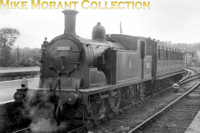 """Pull-push fitted Drummond M7 0-4-4T no. 30051 attached to an LBSCR auto-coach at Christ's Hospital station on the line from Horsham to Shoreham that would close on 7/3/66. [Mike Morant collection] This is very poor negative and ordering prints from this image larger than 6"""" x 4"""" isn't recommended."""