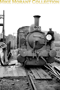 """LCGB: The """"B4"""" Dock Tank Rail Tour (No.1) 9/3/63 Adams B4 dock tank No. 30096 has just taken on water at Winchester. This relatively short trip started at Winchester Chesil, visited Ocean Terminal in Southampton, Eastleigh works and then terminated at Winchester City. 30096 had originally been named Normandy and would be named again when sold out of service to Corrall who named her Corrall Queen. In 1972 he was again sold on but this time to the Bulleid Pacific Preservation Society (later renamed The Bulleid Society) and the locomotive is, of course, now located on The Bluebell Railway."""