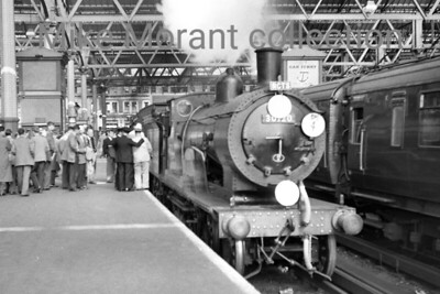 RCTS: The Sapper 4/10/58/ Drummond T9 'Greyhound' 4-4-0 no. 30120 at Waterloo station. 30120 woukld take the participants as far as Liss and then bring them back from Bordon. 30120 was fortunate and was set aside for preservation when withdrawn at Eastleigh in July 1963 and is still with us today. [Mike Morant collection]