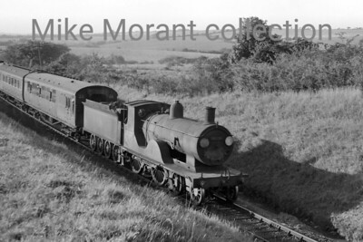 Drummond T9 'Greyhound' 4-4-0 no. 30338, in charge of a passenger service heading for Okehampton, nears Maddaford Moor Halt on 8/9/60. [Mike Morant collection]