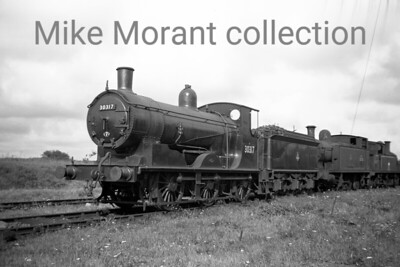 Drummond 700 'Black Motor' 0-6-0 no. 30317, a Salisbury engine at the time, obviously not long out of works and depicted at Eastleigh on 28/8/56.