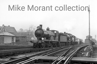 Ian Allan: Ashford & Eastleigh Works 12/4/61 Drummond T9 'Greyhound' 4-4-0 no. 30117 pilots Maunsell D1 class 4-4-0 no. 31749 as the special arrives at Redhill station. This combo had brought the train from Charing cross to Ashford and were turned there for the leg to Redhill via Tonbridge. This tour was run to cope with the overbooked original which ran a week previously.