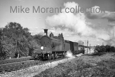 Dorchester allocated Drummond L11 class 4-4-0 no. 413 in charge of a freight bound for Poole and photographed at Branksome in 1948. 413 would never be BR branded and was withdrawn at Nine Elms in February 1951. [Mike Morant collection]