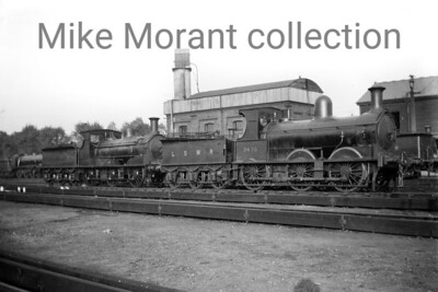This is  Strawberry Hill motive power depot on October 1st, 1921. The 0-6-0 nearest the camera is Single Framed Beyer Goods no. 347A which dated from August 1876 and was renumbered with the 'A' suffix, clarifying that it was already on the duplicates list, in February 1916 and would be withdrawn in Septembert 1925. The second loco, an Adams 0395 0-6-0, isn't identifiable unfortunately. [H. C. Casserley / Mike Morant collection]