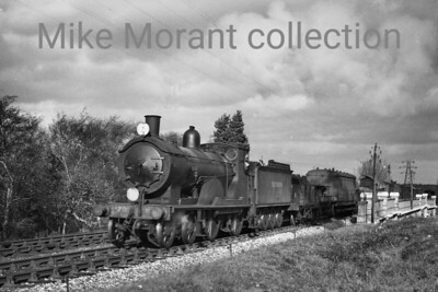 Eastleigh allocated Drummond T9 'Greyhound' class 4-4-0 no. 711 in charge of a freight bound for Poole and photographed at Branksome in 1948. 711 was in unlined Maunsell green with Bulleid lettering all of which had been applied as far back as January 1941 according to Bradley. BR numbering and lined black livery would be applied in May 1949 and 30711 would be withdrawn at Exmouth Junction in August 1959. [Mike Morant collection]