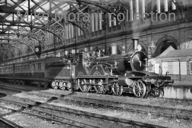 LSWR Adams X2 class 4-4-0 no. 588 awaits departure from Bournemouth Central whilst in charge of a Waterloo-bound service in the first decade of the 20th century. No. 588 had been built at the LSWR's Nine Elms Works in November 1891 and is depicted here following modifications by Drummond. Withdrawal came in March 1932.<br> [<i>Mike Morant collection</i>]