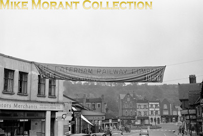 Caterham Railway Company: Caterham Centenarian 6/8/56 An appropriate banner advertising the event outside Caterham station. [Mike Morant collection]